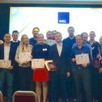 warwick employment group staff holding awards at annual conference