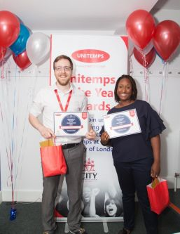 man and woman holding certificates and goody bag at unitemps of the year awards at city university